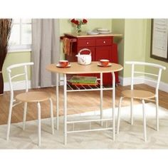Bistro Dining Set will add a touch of elegance to your kitchen dining area. Bistro Dining Set includes 1 table and 2 chairs. Bistro Dining Set Specification Bistro Dining Set 3-Piece Just slide the chairs under the table to create a greater space in your kitchen area.   eBay!