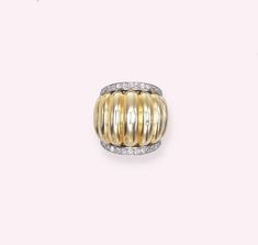 A DIAMOND AND GOLD RING, BY SUZANNE BELPERRON The ribbed gold tapered band flanked by diamond borders, circa 1940, ring size 5, with French assay mark for gold With maker's mark GD flanking a fleur-de-lys for Groené et Darde With certificate by Jean Herz dated 22 March 2004 stating that the ring was created by Suzanne Belperron circa 1950