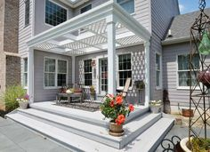 If you think you don't have enough room for a deck, think again. Take a page out of this homeowner's book and squeeze a small structure into a corner on the back of the house. Brilliant!