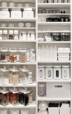White shelves, storage containers. (Different types of containers.)