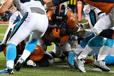 running back C.J. Anderson (22) of the Denver Broncos scores a go-ahead touchdown agains the Carolina Panthers during the fourth quarter. The Denver Broncos hosted the Carolina Panthers on Thursday, September 8, 2016.