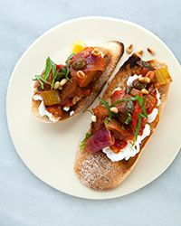 Caponata Crostini with Goat Cheese and Toasted Pine Nuts | This eggplant based relish is a delicious accompaniment to just about everything. It's like a Sicilian version of ratatouille and best served with a wide range of meats and fish, on toast, or used as a sauce with pasta.