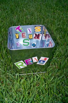 Cut letters from magazines and attach to sticky side of magnetic sheet.  Keep in a metal bucket and students can make words on the sides.