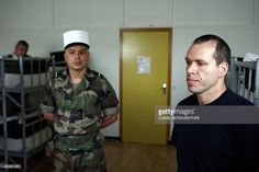 MOUTOT - A recruit of French Foreign Legion and a soldier wait in a dormitory at the recruitment center in Fontenay-sous-bois, outside Paris on June Thousands of potential recruits knock on. Strong Force, Marine Commandos, French Foreign Legion, Royal Marines, Dormitory, June 22, France, Paris, Stop Staring