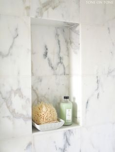 Custom soap niche of Calacatta marble in the shower.