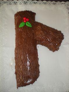 Tronquito de Navidad envuelto de chocolate con leche, y relleno de crema de vainilla!