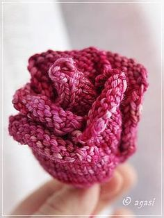 Free Knitting Pattern for Rose - This knitted rose is based around a central bud. Petals are built up in alternating sets of two and three, then a stem is added.Designed by Jessica Goddard. Pictured project by agasi.