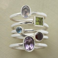 SPECTRUM RINGS, SET OF 5 -- Five sterling silver bands are set ablaze with garnet, blue topaz, amethyst, peridot and rainbow moonstone. Set of Whole and half sizes 5 to Jewelry Rings, Silver Jewelry, Jewelry Accessories, Unique Jewelry, Jewlery, Fashion Accessories, Handmade Rings, Glamour, Jewellery Storage