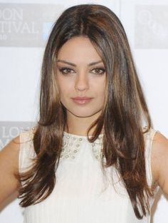 Mila Kuniz Layered Parted Hair Style with Subtle Highlights