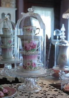 stack tea cups & saucers under cloche