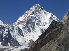 "K2 (also known as Savage Mountain, ) is the second-highest mountain on Earth. With a peak elevation of 8,611 m (28,251 feet), K2 is part of the Karakoram Range, located on the border[2] between Baltistan,   Pakistan, and Xinjiang, China. K2 is known as the Savage Mountain due to the difficulty of ascent and the second-highest fatality rate among the ""eight thousanders"" for those who climb it. For every four people who have reached the summit, one has died , K2 has never been climbed in winter."