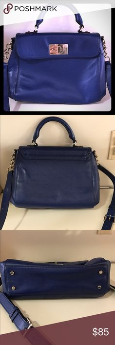 Kate Spade blue cross body Beautiful authentic Kate Spade. Royal blue, can be carried as cross body or by top handle. Flap secures with a turn lock closure. Interior is fun polka dot print with one zip pocket and two small pockets. Very lightly used. Stored in dust bag and in sealed container when not used. kate spade Bags Crossbody Bags