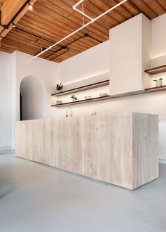 StudioAC has designed loft conversion in an old candy factory in Toronto, Canada. Called Candy Loft, the one-bedroom apartment measures Espresso Kitchen Cabinets, Dark Cabinets, Arched Cabin, Loft Interiors, Apartment Renovation, Contemporary Apartment, One Bedroom Apartment, Loft Spaces, Loft Apartments