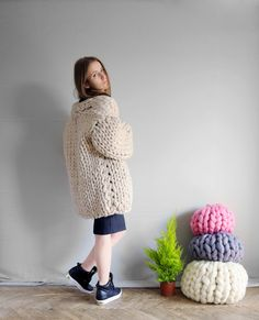 Mezzo punto. Cardigan. Merino wool. A stylish way to resist cold weather.