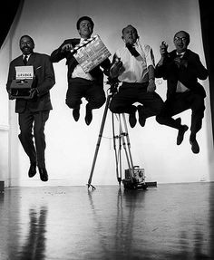 Fritz Gruber (Writer) and the Crew Jumping on Set 1962 by Philippe Halsman