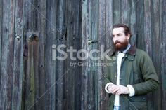 Young man against rustic wooden background Royalty Free Stock Photo