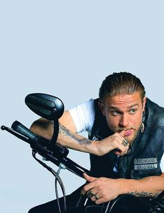 Love bad boy Jax Teller (aka Charlie Hunnam). Season 6 of SOA starts next week. So set your DVRs to see the future Mr. Grey in action :)