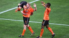 DURBAN, SOUTH AFRICA - JUNE 28: Dirk Kuyt of the Netherlands picks up Wesley Sneijder in celebration after he scored the second goal during the 2010 FIFA World Cup South Africa Round of Sixteen match between Netherlands and Slovakia at Durban Stadium on June 28, 2010 in Durban, South Africa. (Photo by Steve Haag/Getty Images)