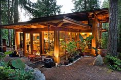 Natural building materials in such a zen setting.  I would love such a home.