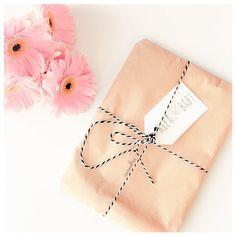 Brown Paper Packages, Tied Up with String... instagram.com/mintandfizz #brownpaperpackages #pink #gerberas #styling #packaging #flatlay