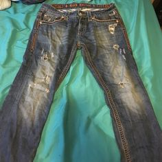 Rock revival Jeans MENS! good condition. minor wear and tear. nothing wrong with them! Width - 33 Length- 34 asking 60$ OBO. will consider all offers! Rock Revival Jeans Straight Leg