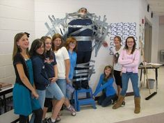 Great Meadows Middle School students tape principal to the wall to raise money for American Cancer Society