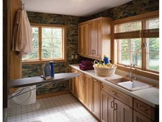 The is a great laundry room and with plenty of windows making it actually a plesant place | Plan 072D-0030 | House Plans and More