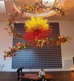 Dramatic floral art installation at a museum