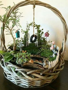 I've never seen a fairy garden in a basket before. Very creative.