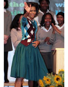 Michelle Obama Fashion from Harper's Bazaar. I love the full skirt and cardigan combo. The color is beautiful.