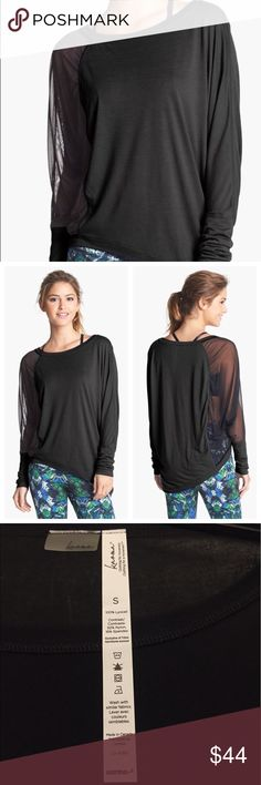 Karma Millay Long sleeve Cover Up Exaggerated and feminine long sleeve cover up with a boat neck, side mesh detailing, and asymmetrical hem.  Made with incredibly lightweight Eucalyptus Jersey that offers natural breathability and moisture wicking properties. Karma Tops
