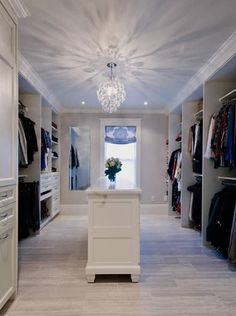 A walk in closet done by local Interior Designer MaryLynne Meschino from Allegro Interiors. It also features a chic stacked washer/dryer com...