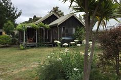 Book this holiday house in Mapua, Oceania. View photos, facilities and availability. Holiday house rental: 1 Bedroom, Sleeps 4 in Mapua New Zealand Houses, Jetted Tub, Holiday Accommodation, Exterior Lighting, Rental Property, Kid Beds, Kayaking, Places To Go, Cottage