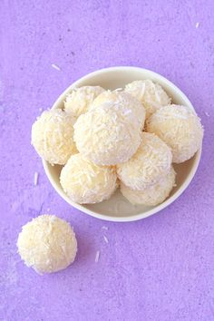 Four ingredient White Chocolate Truffles rolled in coconut. Deliciously creamy no bake White Chocolate Ganache Truffles, made with cream and butter - perfect for Christmas gift-giving! Find the easy recipe on sweetestmenu.com #truffles #whitechocolate #christmas