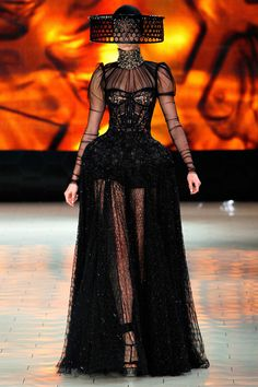 This dress from Alexander McQueen's Spring 2013 collection resembles the all-black mourning costumes that were worn toward the end of the 1800's. When Queen Victoria's husband died in 1861, she wore mourning attire for the rest of her life. This tradition eventually spread to all classes. --4/6/15