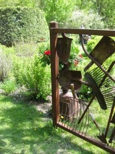 Garden gate made out of vintage garden tools.