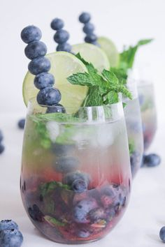 Blueberry-Mojito-Royale-with-Champagne-1/3 cup blueberries (plus extra for a fancy blueberry swizzle stick) 6-8 leaves fresh mint 1 tablespoon sugar in the raw (I'm into slightly tart cocktails, but feel free to add an extra teaspoon or two of sugar if you like a sweeter drink.) 2½ tablespoons fresh lime juice 2 ounces light rum Crushed ice 2 ounces chilled Prosecco or champagne