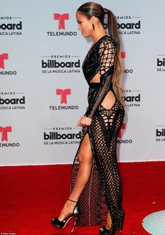 Famous curves: J-Lo had her famous curves on display in the dress...