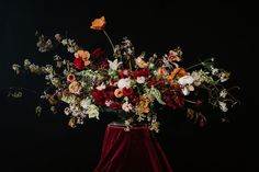 Inspired by Dutch Masters, these dark and moody florals channel 16th and 17th century Northern painters. A black backdrop makes the dark burgundy and golds pop.