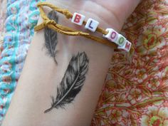 feather tattoo on the wrist.