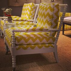 Spool chairs in yellow chevron at C. R. Laine