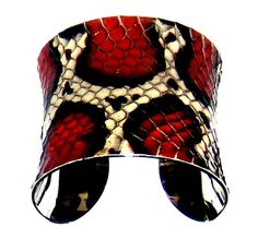 Hey, I found this really awesome Etsy listing at http://www.etsy.com/listing/62445880/black-red-and-ivory-snakeskin-cuff