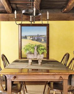 Lemony yellow walls seem to glow within the context of the home's original wood beams and the burnished warmth of a c. 1800 church pew, transformed into a dining table by a local craftsman.
