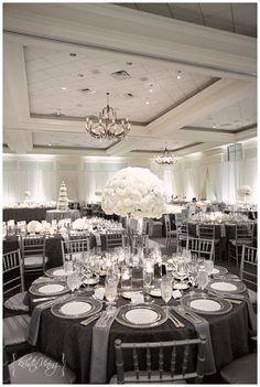 silver and white wedding reception, hurricane vase center pieces, custom linens, silver chiavari chairs, clear glass chargers- I think this is at Ballantyne resort Wedding Themes, Wedding Colors, Silver Wedding Decorations, Wedding Flowers, Wedding Ideas, Grey Wedding Theme, Decor Wedding, Wedding Favours, Wedding Photos