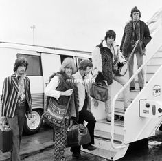 Members of The Rolling Stones heading for New York, Left to right: Brian Jones, Charlie Watts, Keith Richards, Bill Wyman with photographer and friend Michael Cooper far left. 13th September 1967.