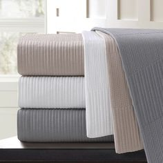 Quilted blankets made with 100% cotton, 200 thread count sateen and filled with poly fiber fill.  150 GSM fill weight.  Self binding finish.