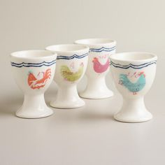 Rooster Egg Cups, Set of 4 | World Market | Easter Decorations.  Perfect to place painted egg shells with Succulents in for Easter.  Cacti would look great in them, too!