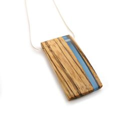 pendant handcrafted from zebrawood with a semi-translucent blue resin stripe