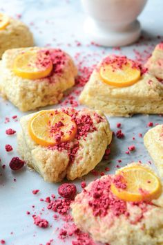 How pretty are these Meyer Lemon Scones with Raspberry Crumbs? This gorgeous dessert is easier to make than it looks and they'll look so cute displayed on a dessert tray at a party.