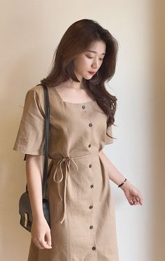 Looking fresh and chic in this earth toned button-up midi dress!